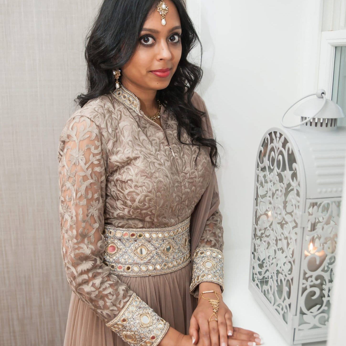 Indian bride at her engagement wearing a long reception dress