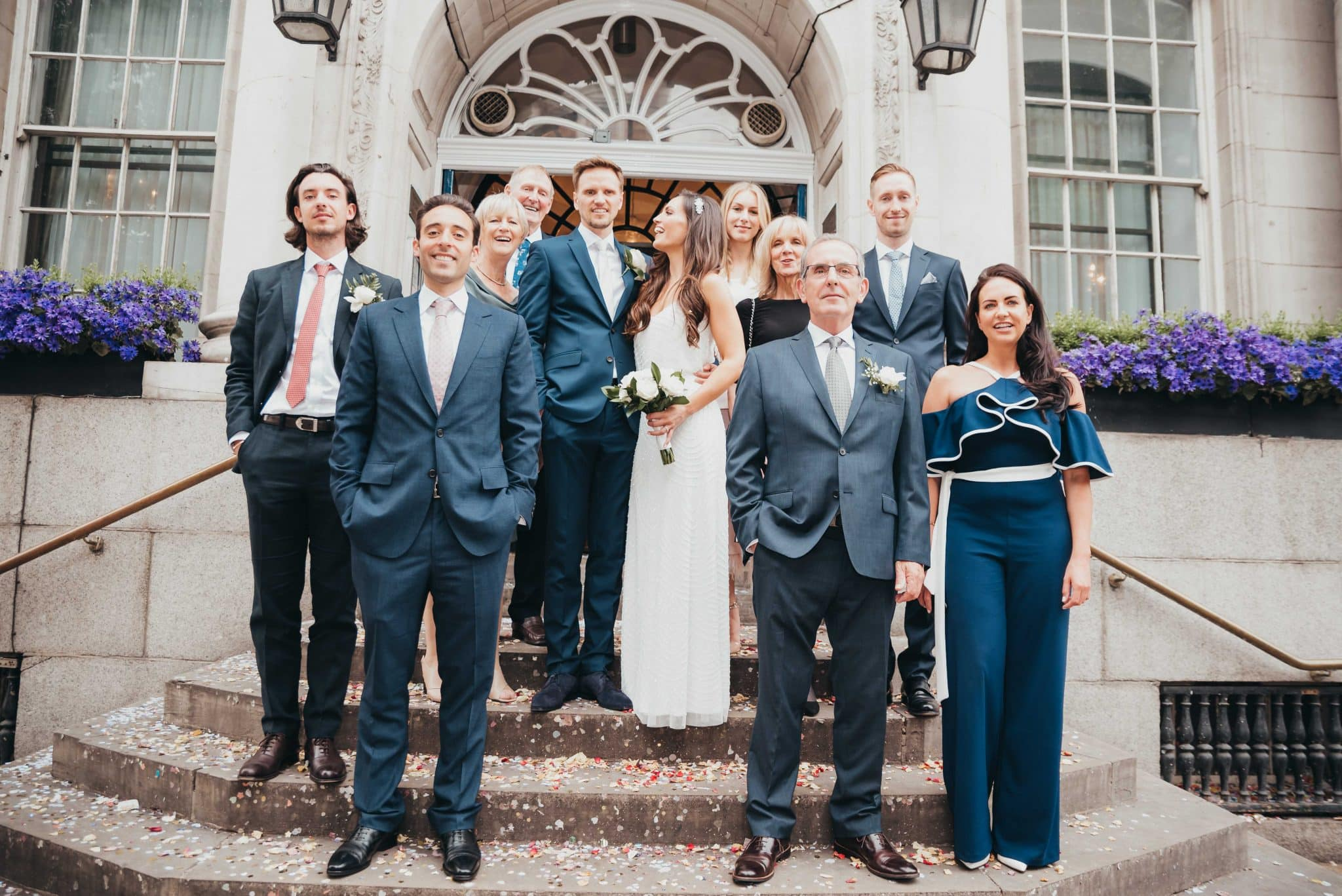 Married couple and the family at the steps of at the registry office group shot