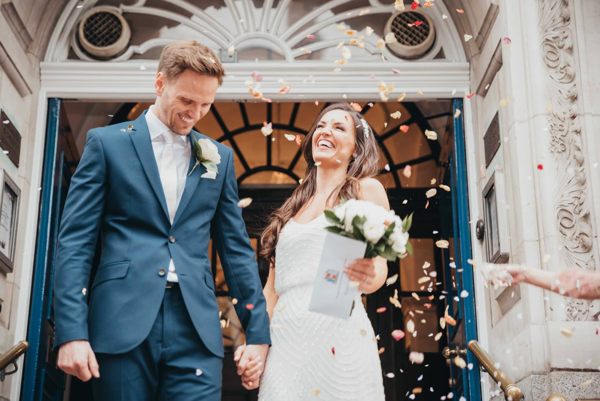 Married couple at the registry office, confetti time after the vows