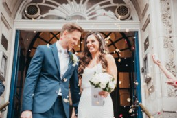 Married couple at the registry office, confetti shot,