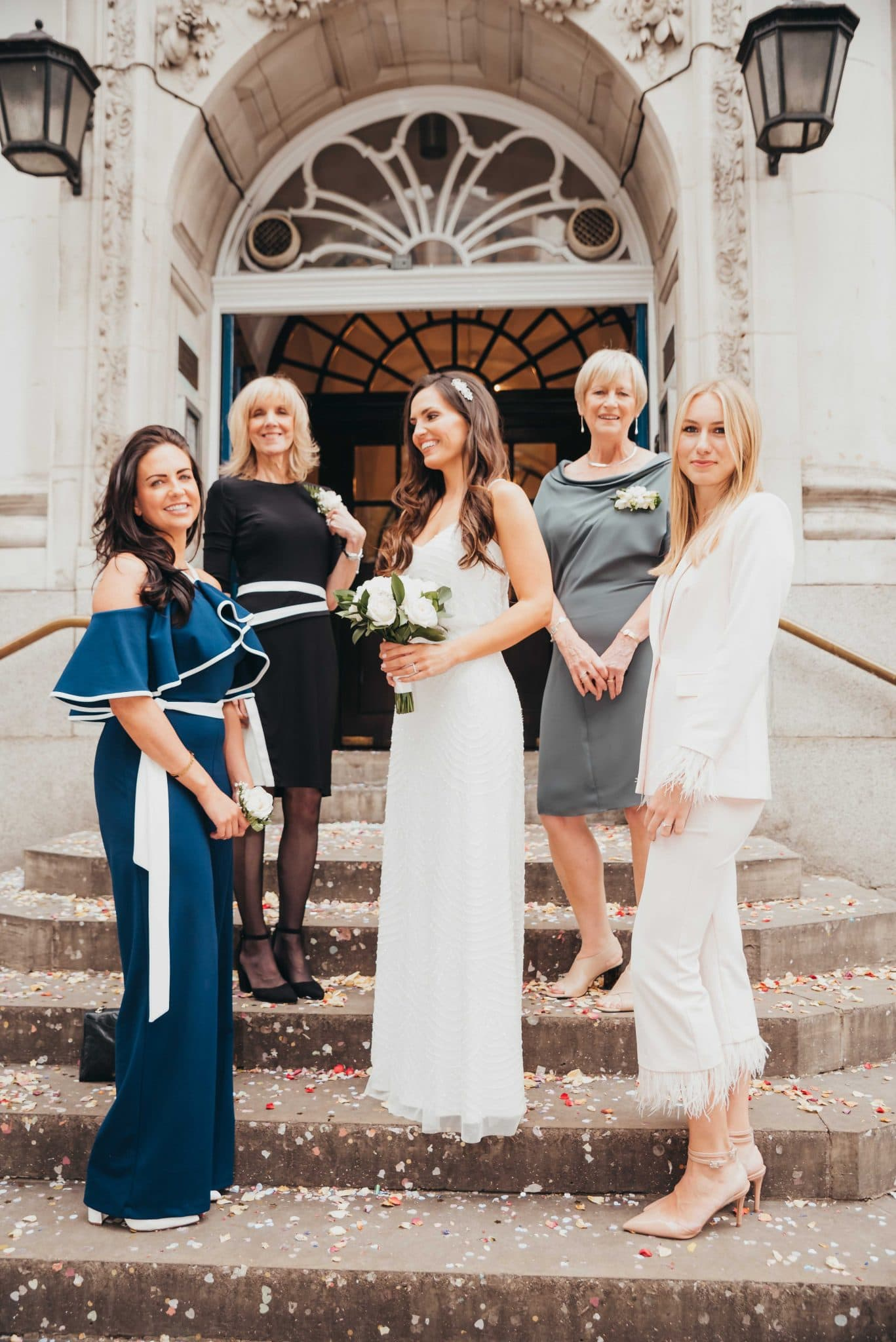 Married couple at the registry office, bride with the bridemaids, photography by Roshni Photography