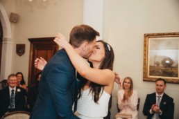 Married couple at the registry office kissing after the vows