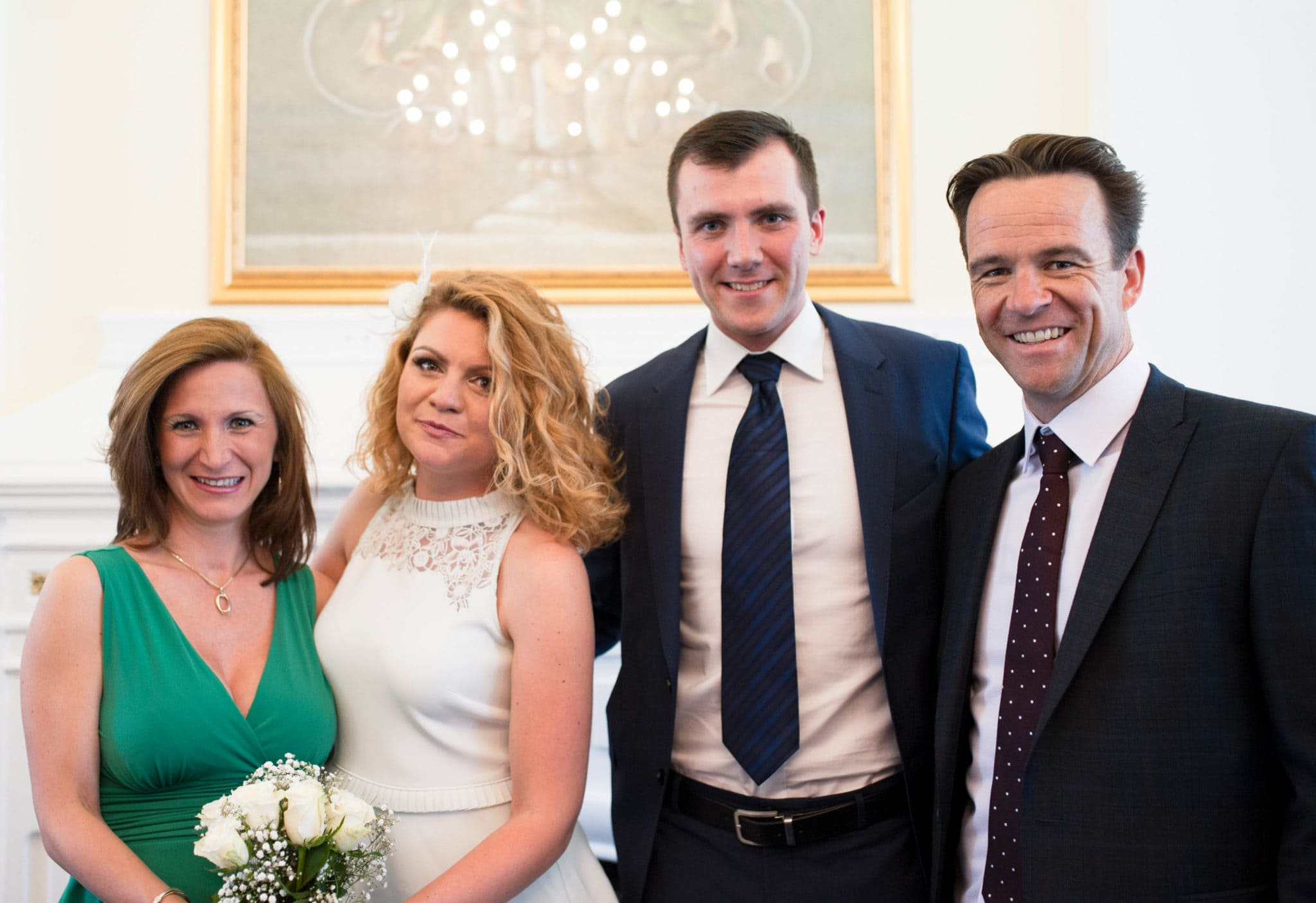 bride and groom Bromley on Bow Registry office, London UK Wedding photography ceremony room with the guest