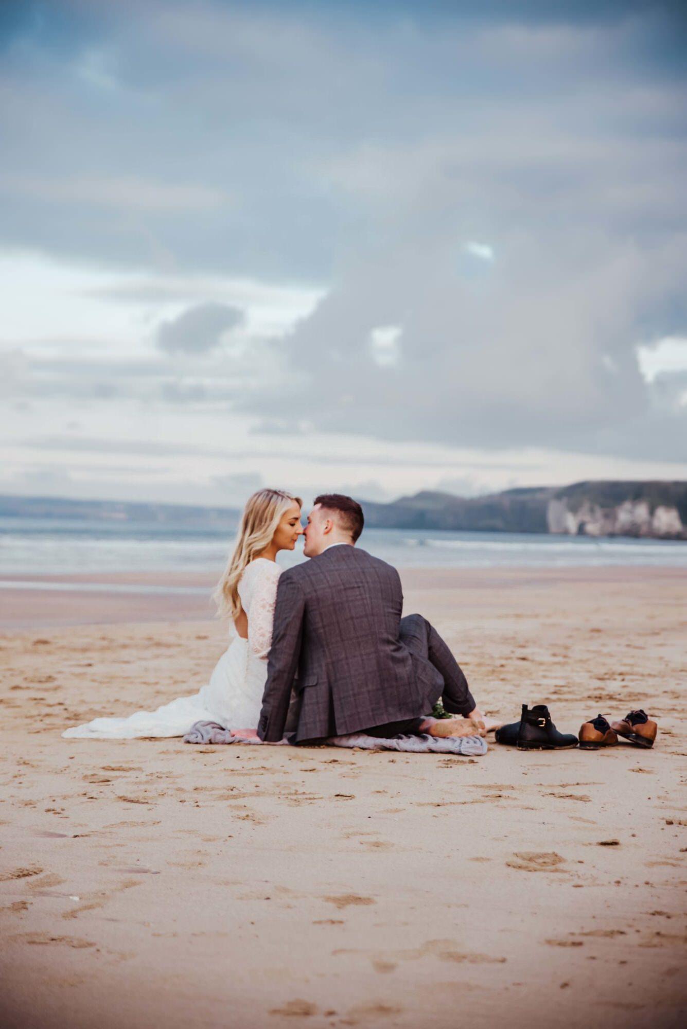 Wedding, bride, and groom walking at the beach . Wedding photographer london
