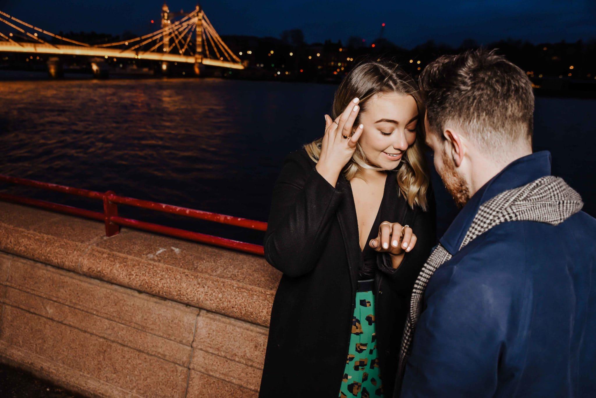 couple near the chelsea bridge london