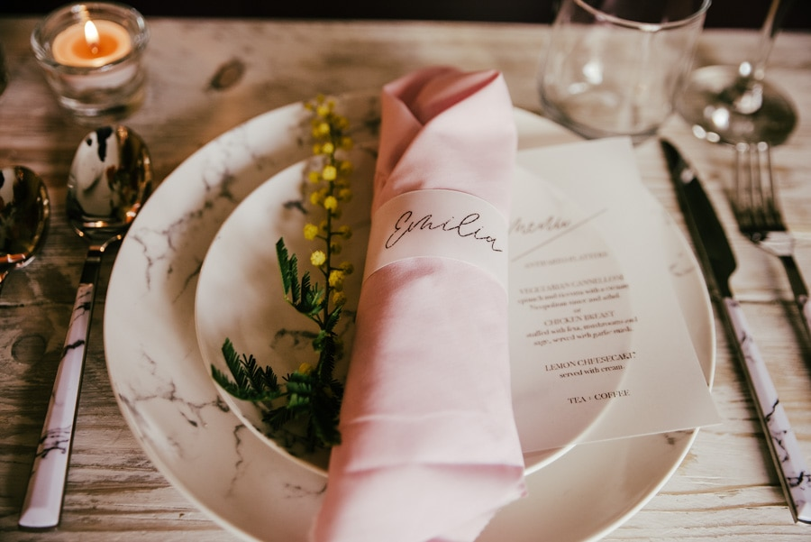 Wedding menu on the dinner plate , on a traslucent paper