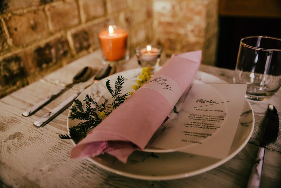 Wedding invites and menu on the wedding plates