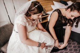 Wedding brides maids at the hotel, Hilton watford Celebratory drink, Sarah tieng her shoes lace- converse shoes for wedding shoes