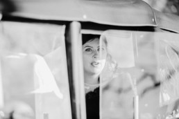 Sarah the bride arrives in a car, rolls royce white