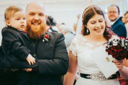 Wedding ceremony , white dress, black suit, red shirt, ring ceremony