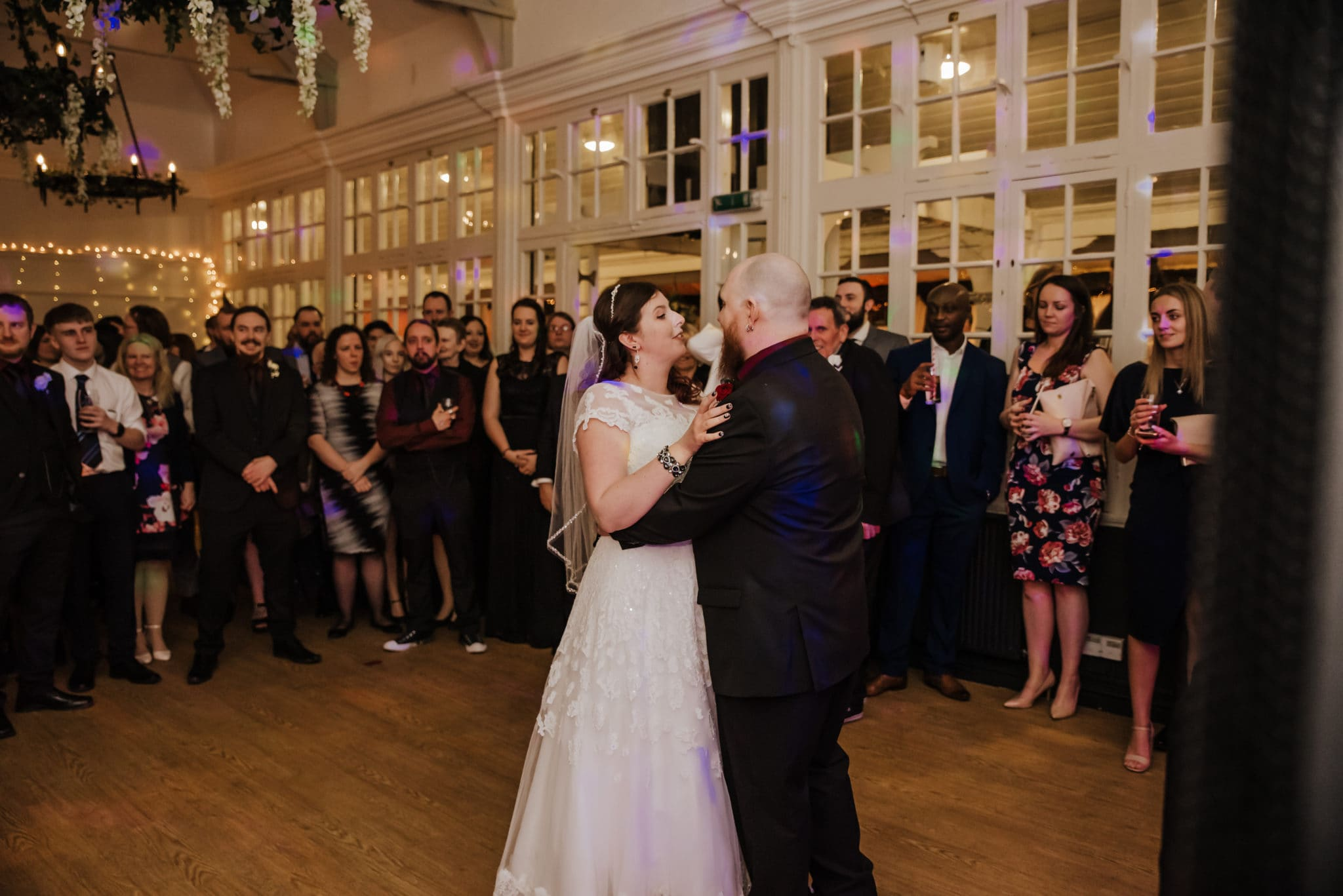 Dancing couple at the wedding reception Shenley cricket club , white wedding dress, black and red themed wedding
