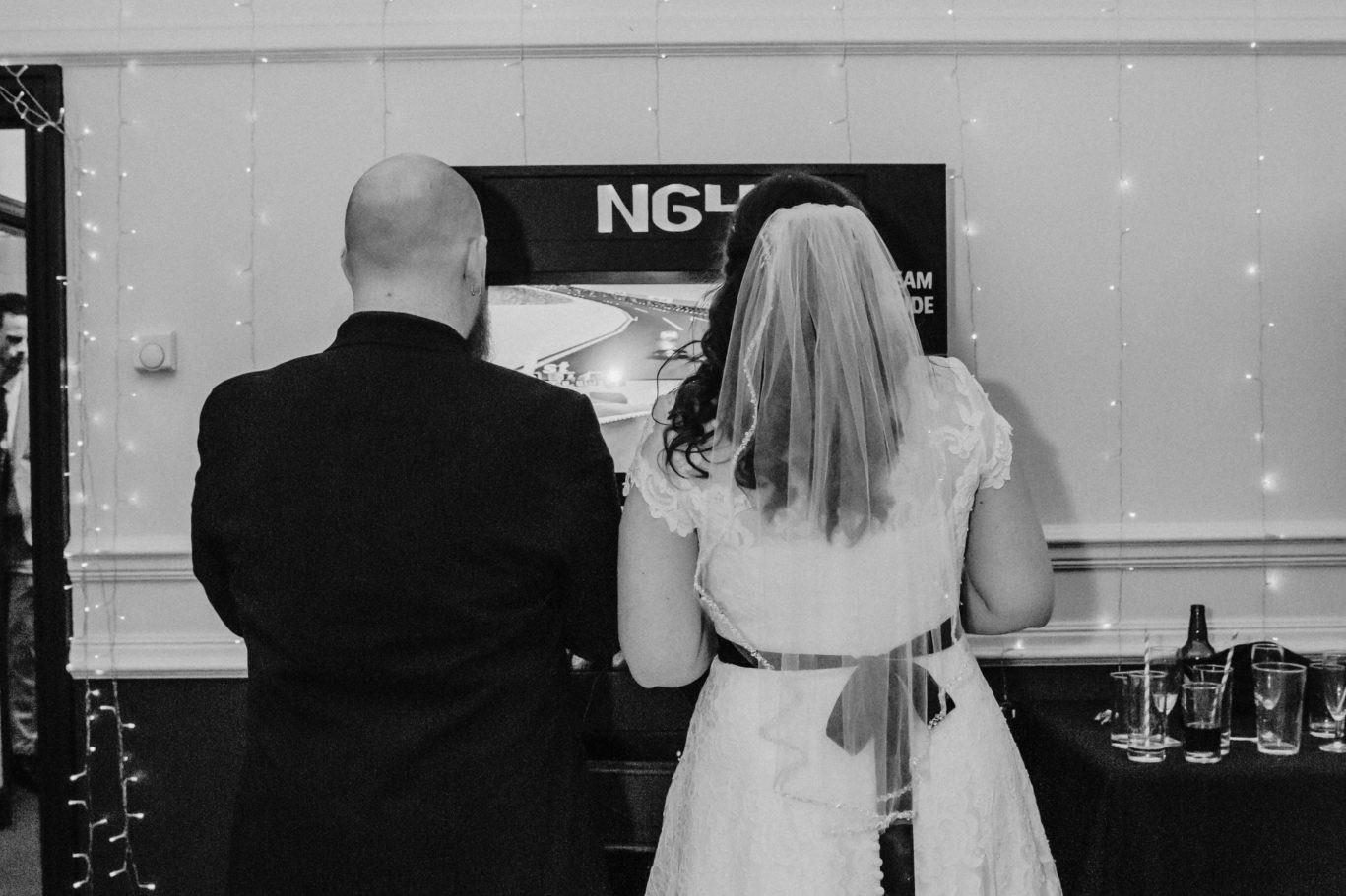 Wedding first dance at the Shenley Cricket club, Sarah and Sam playing NG4 playstaion gaming station
