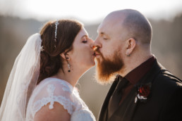 Sarah and Sam wedding couple outside Shenley Cricket club for thei