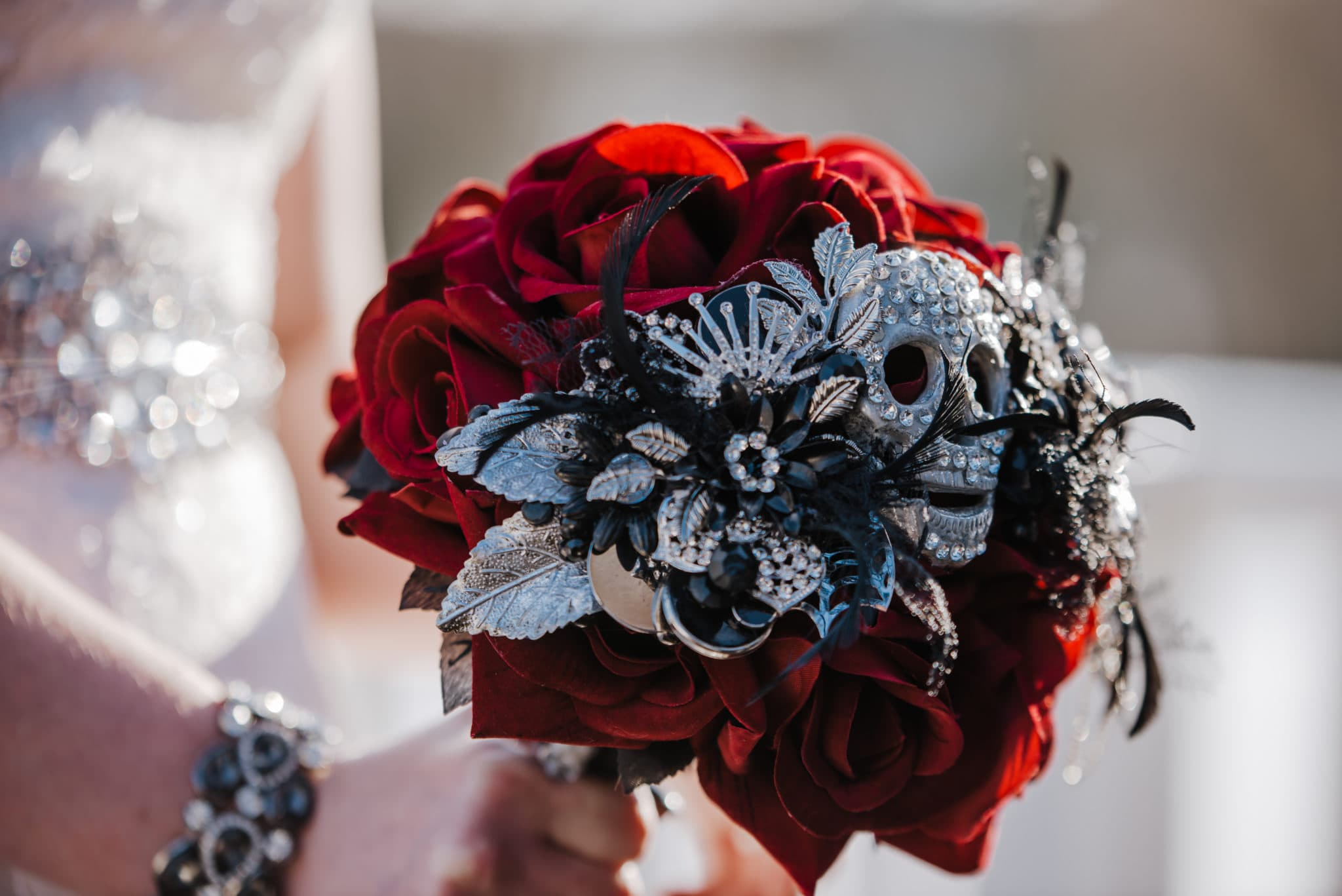 wedding bouquet , red roses, skulls black feathers, diamante , alternative design