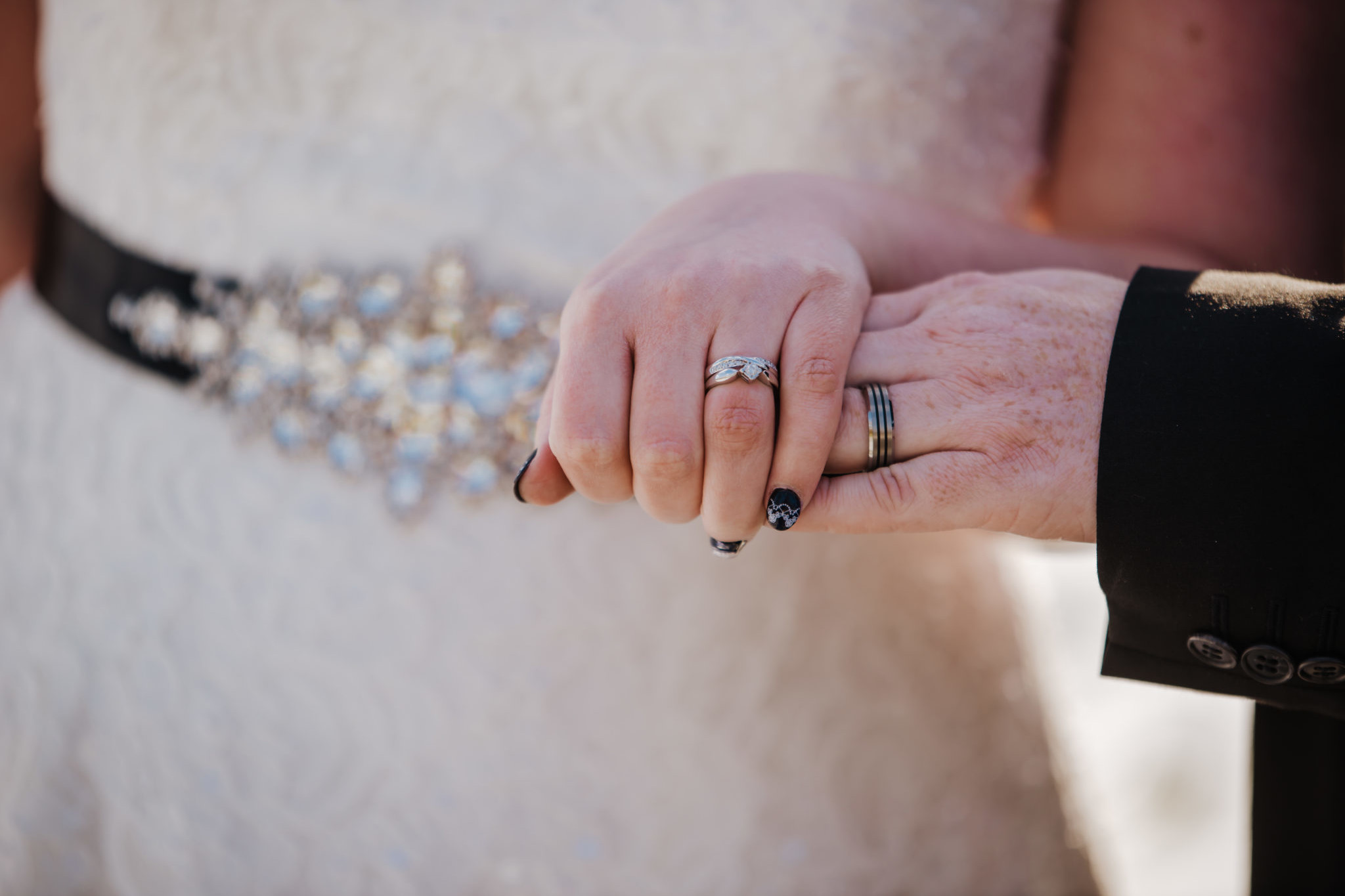 Sarah and Sam weddiing couple outside Shenley Cricket club for thei