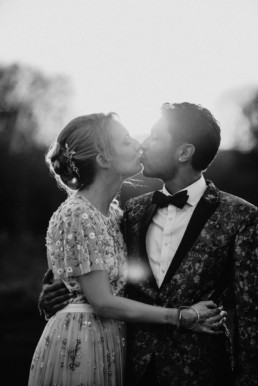 bride and groom looking at each other near sunset