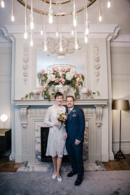 Katya in silk vintage weddign dress, Brett in blue suit at the Old Marylebone registry office london a