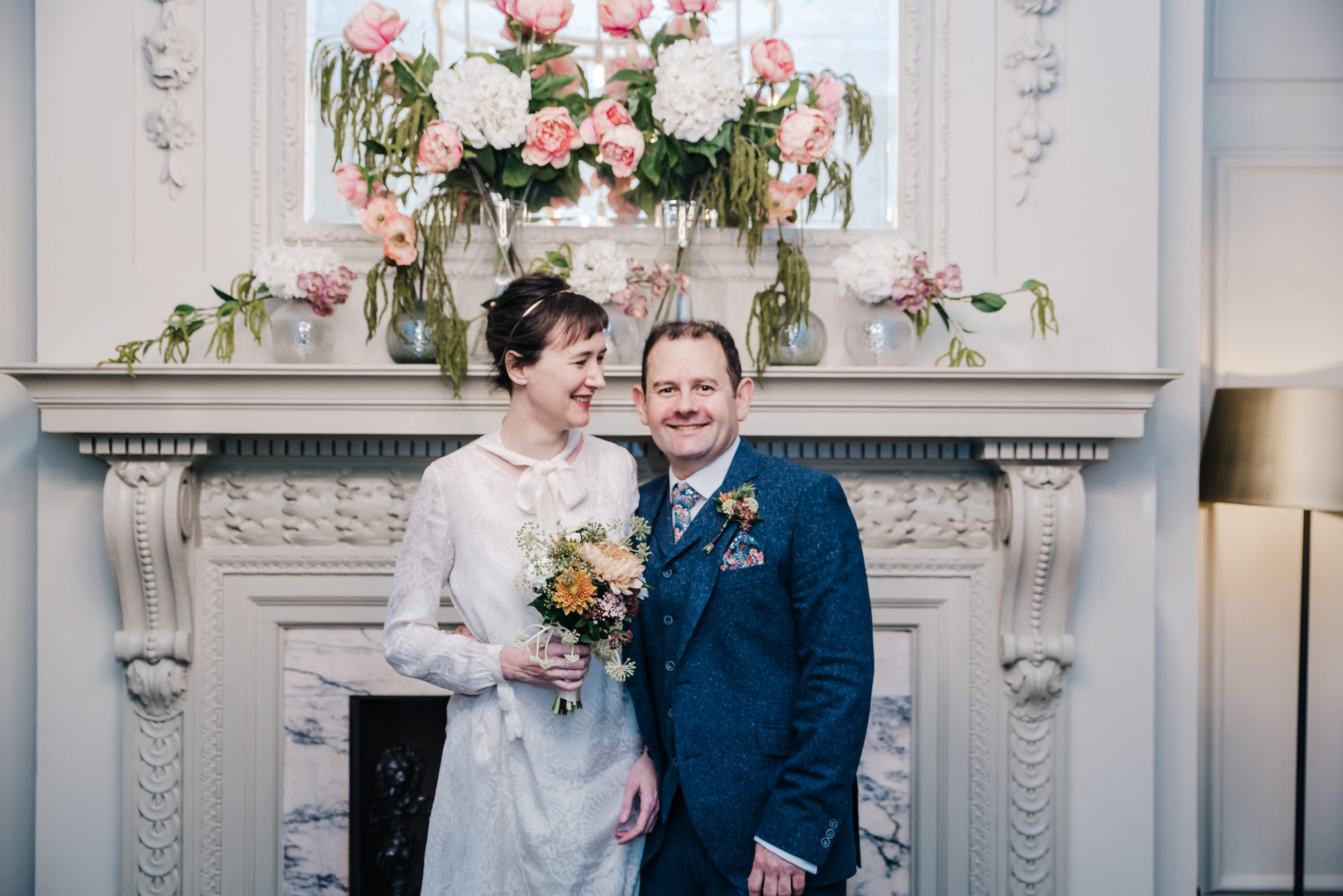 Katya in silk vintage weddign dress, Brett in blue suit at the Old Marylebone registry office london a