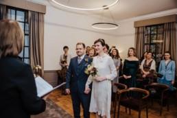 Katya in silk vintage wedding dress, Brett in blue suit at the Old Marylebone registry office london , Ceremony photo