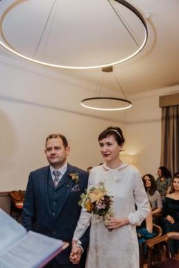 Katya in silk vintage weddign dress, Brett in blue suit at the Old Marylebone registry office london a ceremony