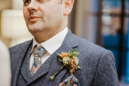 Katya in silk vintage weddign dress, Brett in blue suit at the Old Marylebone registry office London ceremony shot