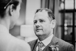 Katya in silk vintage weddign dress, Brett in blue suit at the Old Marylebone registry office london ceremony