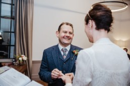 Katya in silk vintage weddign dress, Brett in blue suit at the Old Marylebone registry office london ring ceremony