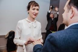 Katya in silk vintage weddign dress, Brett in blue suit at the Old Marylebone registry office London rong ceremony