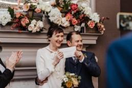 Katya in silk vintage weddign dress, Brett in blue suit at the Old Marylebone registry office London marriage certificate ceremony