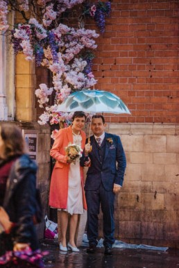 Katya in silk vintage weddign dress, Brett in blue suit at the Old Marylebone registry office London couples shot at the Piccadilly circus