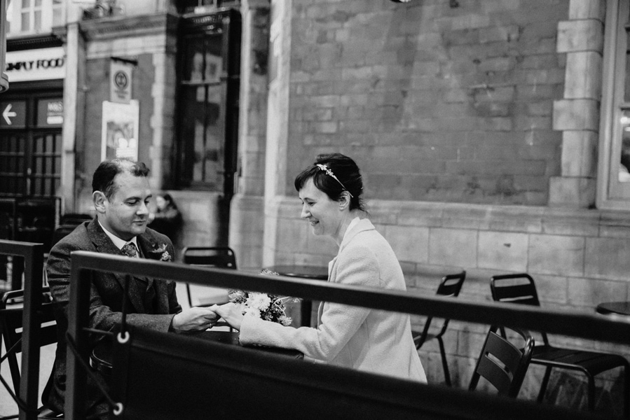Katya in silk vintage wedding dress, Brett in blue suit at the Old Marylebone registry office London couples shot at Piccadilly circus station