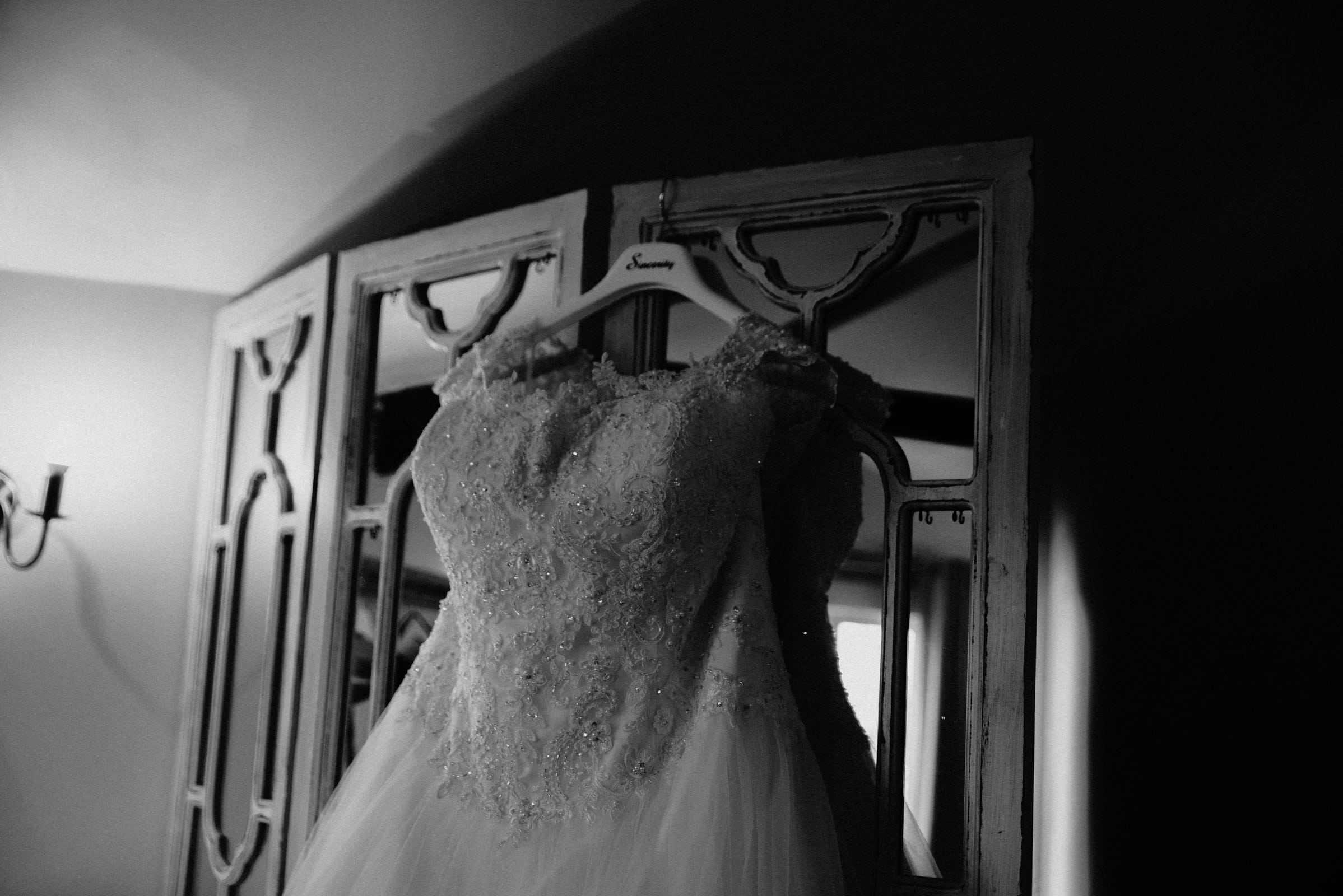 Wedding dress hanging on a closet