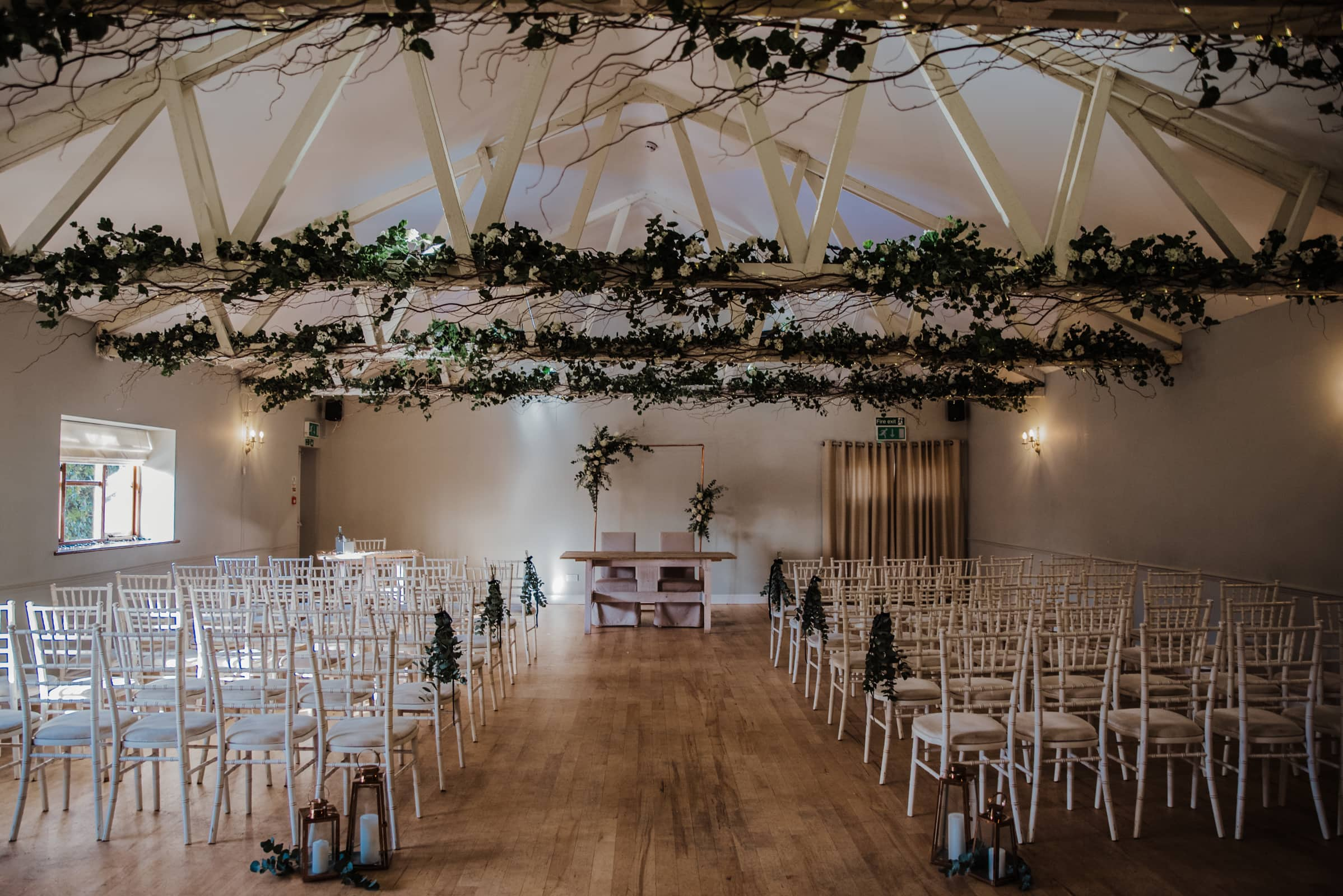 wedding ceremony hall with chairs and deocr Roshni photography The Milling Barn, Bluntswood Hall, Throcking wedding photographer