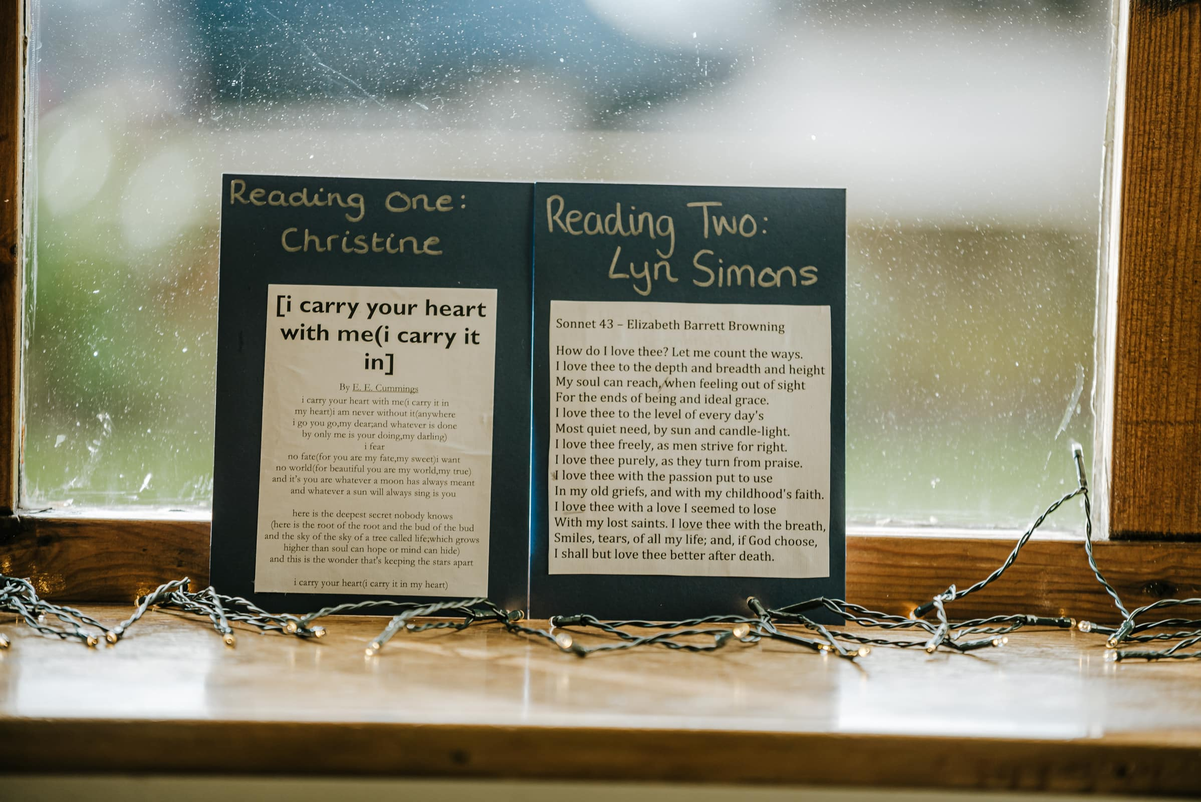 Wedding reading - i carry your heart with me and Sonnet 43 - near the fairy lights, at a window sill Roshni photography The Milling Barn, Bluntswood Hall, Throcking wedding photographer