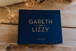 guset book blue and gold Roshni photography The Milling Barn, Bluntswood Hall, Throcking wedding photographer