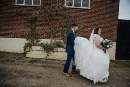 Groom and bride after the wedding ceremony Roshni photography The Milling Barn, Bluntswood Hall, Throcking wedding photographer