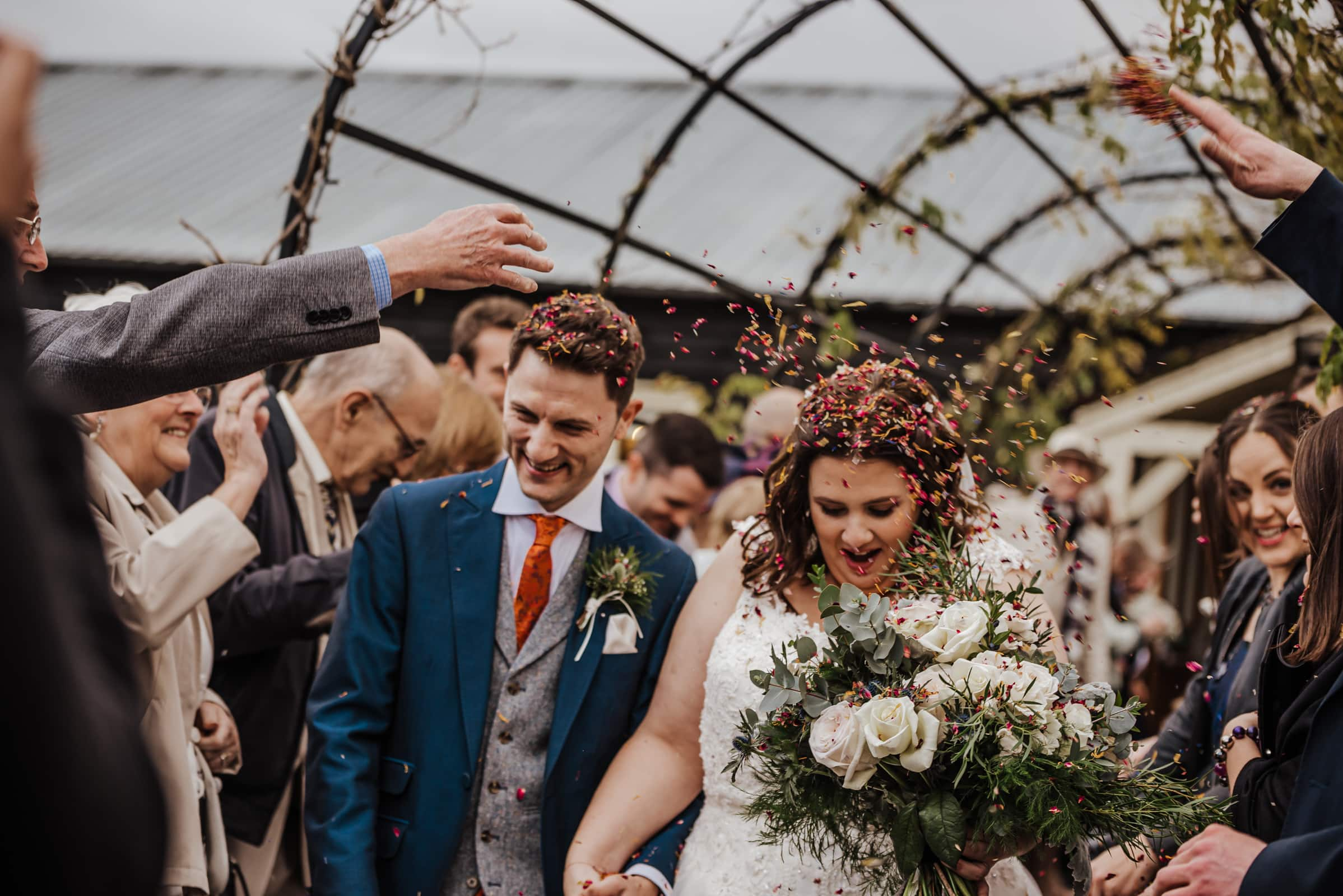 Confetti of Groom and bride after the wedding ceremony Roshni photography The Milling Barn, Bluntswood Hall, Throcking wedding photographer