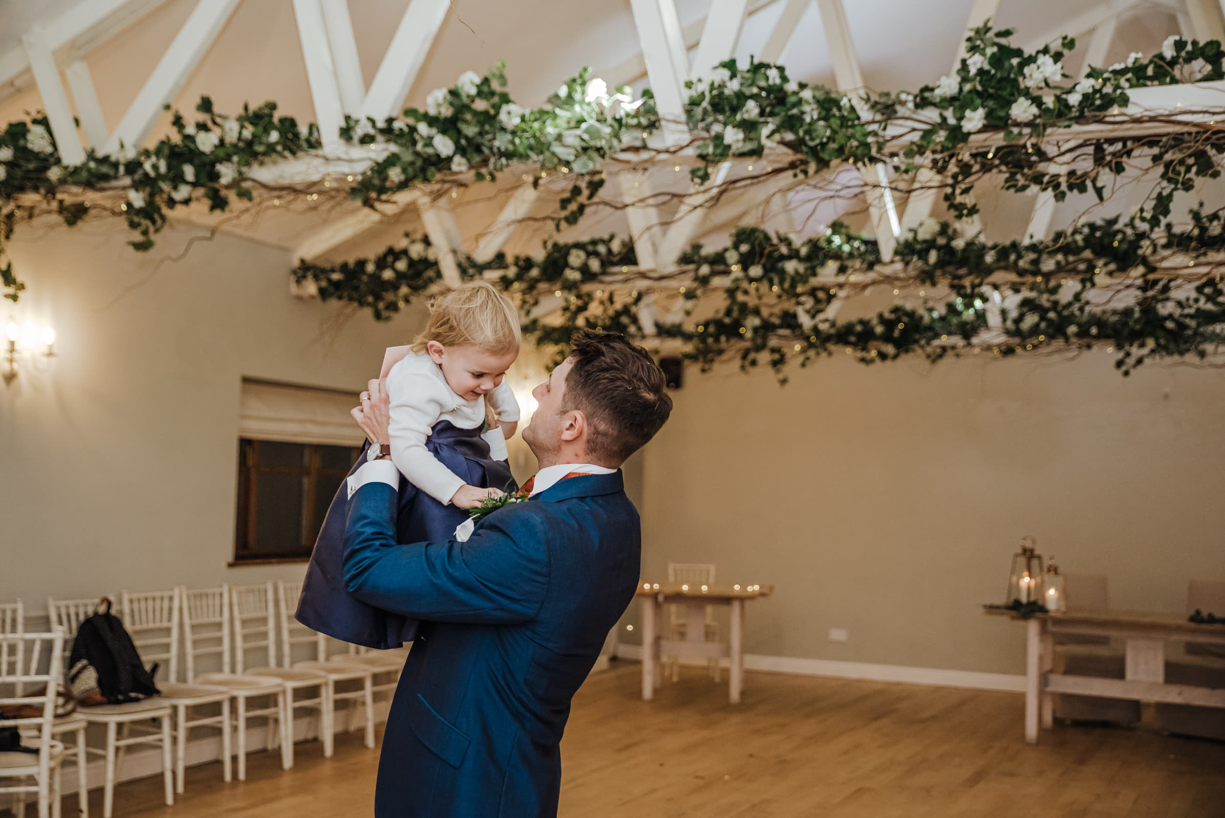 Groom and his daughter after the wedding ceremony Roshni photography The Milling Barn, Bluntswood Hall, Throcking wedding photographer