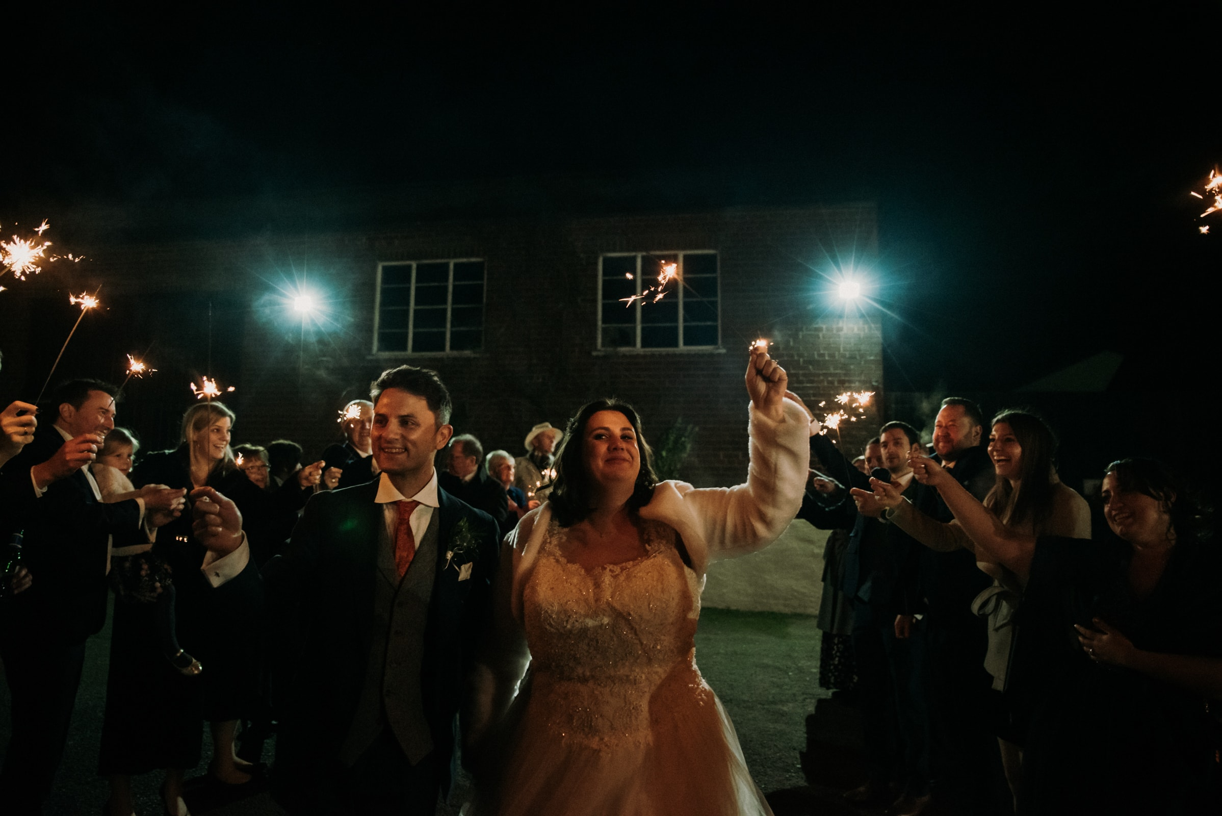 Sparklers exit for the bride ad groom at the reception Roshni photography The Milling Barn, Bluntswood Hall, Throcking wedding photographer