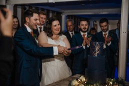 Cake cutting the bride ad groom at the reception Roshni photography The Milling Barn, Bluntswood Hall, Throcking wedding photographer