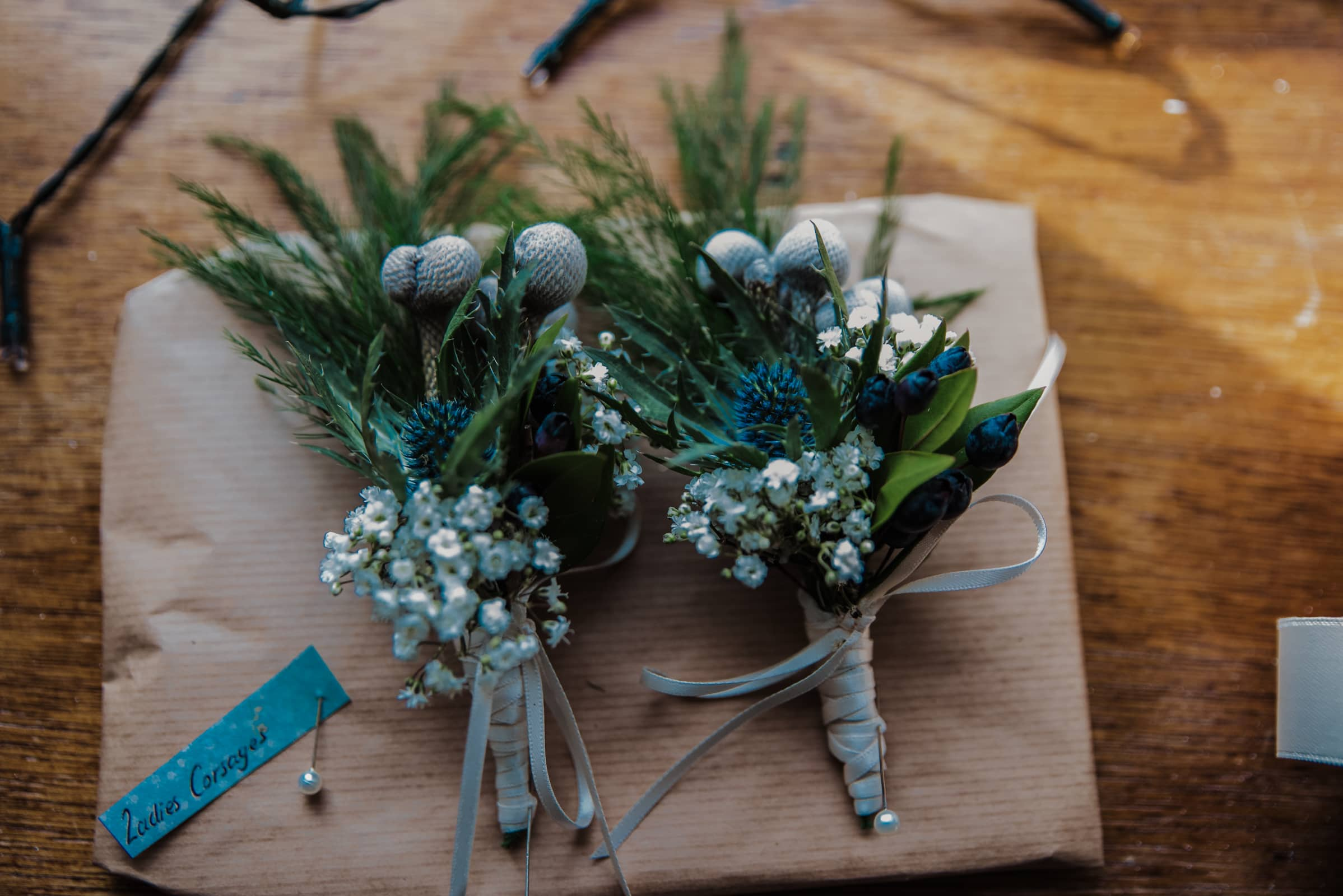 button hole mint and blue Roshni photography The Milling Barn, Bluntswood Hall, Throcking wedding photographer