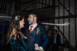 Dancing guests and bride and groom at the reception Roshni photography The Milling Barn, Bluntswood Hall, Throcking wedding photographer