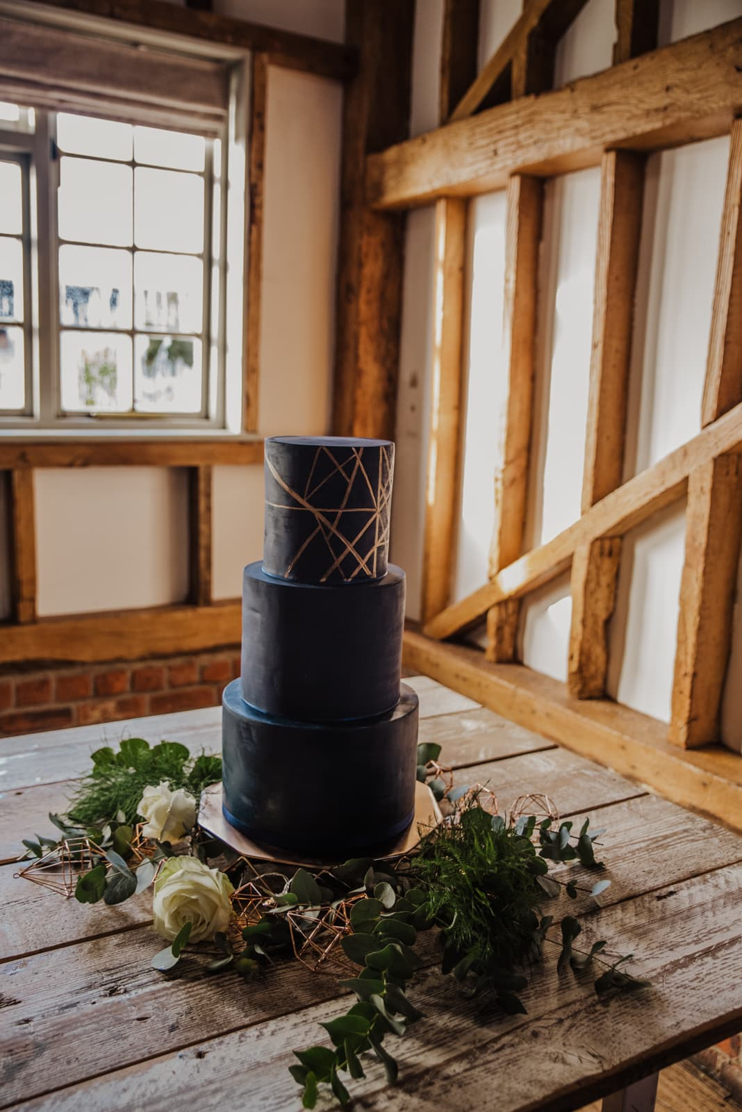 wedding cake decor signs, dinosaur a themed menus Roshni photography The Milling Barn, Bluntswood Hall, Throcking wedding photographer