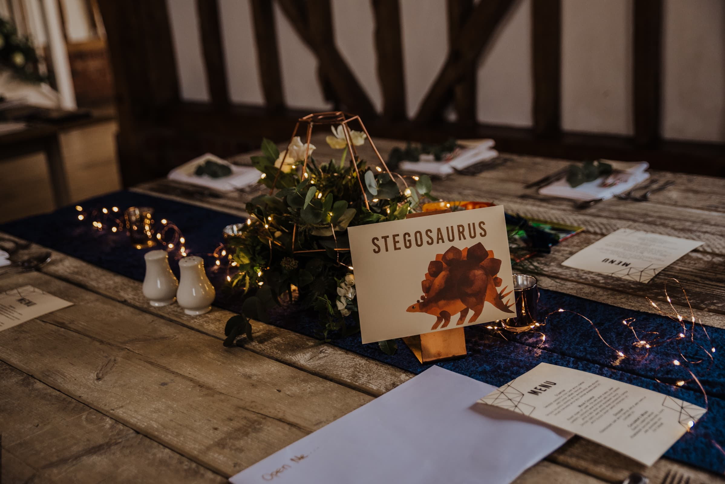 wedding decor signs, dinosaur a themed menus Roshni photography The Milling Barn, Bluntswood Hall, Throcking wedding photographer