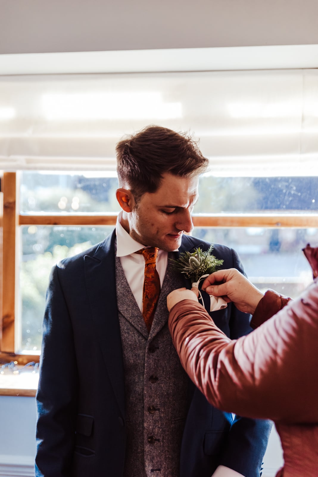 Groom getting ready dinosaur a themed menus Roshni photography The Milling Barn, Bluntswood Hall, Throcking wedding photographer