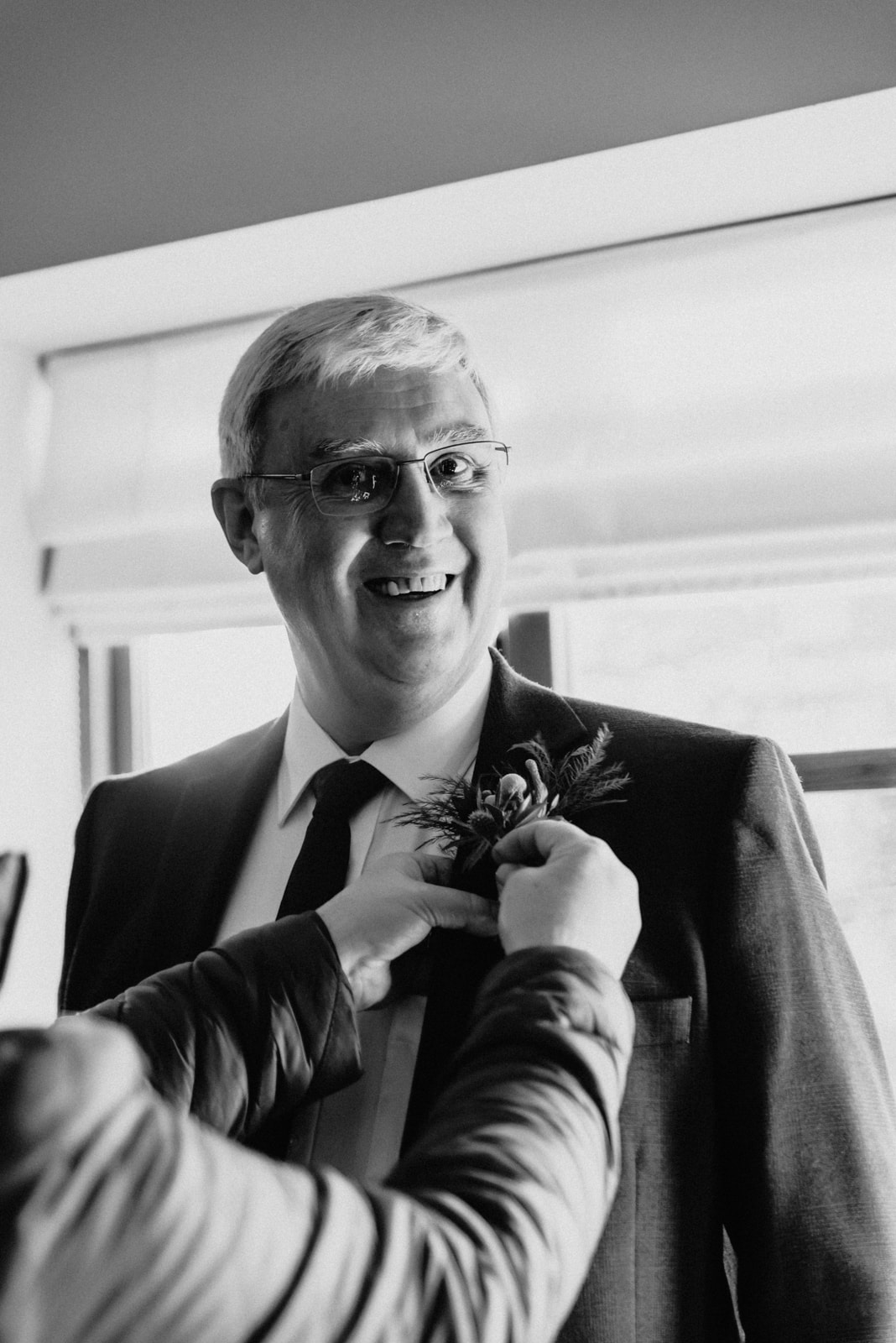 Groom's dad getting ready dinosaur a themed menus Roshni photography The Milling Barn, Bluntswood Hall, Throcking wedding photographer