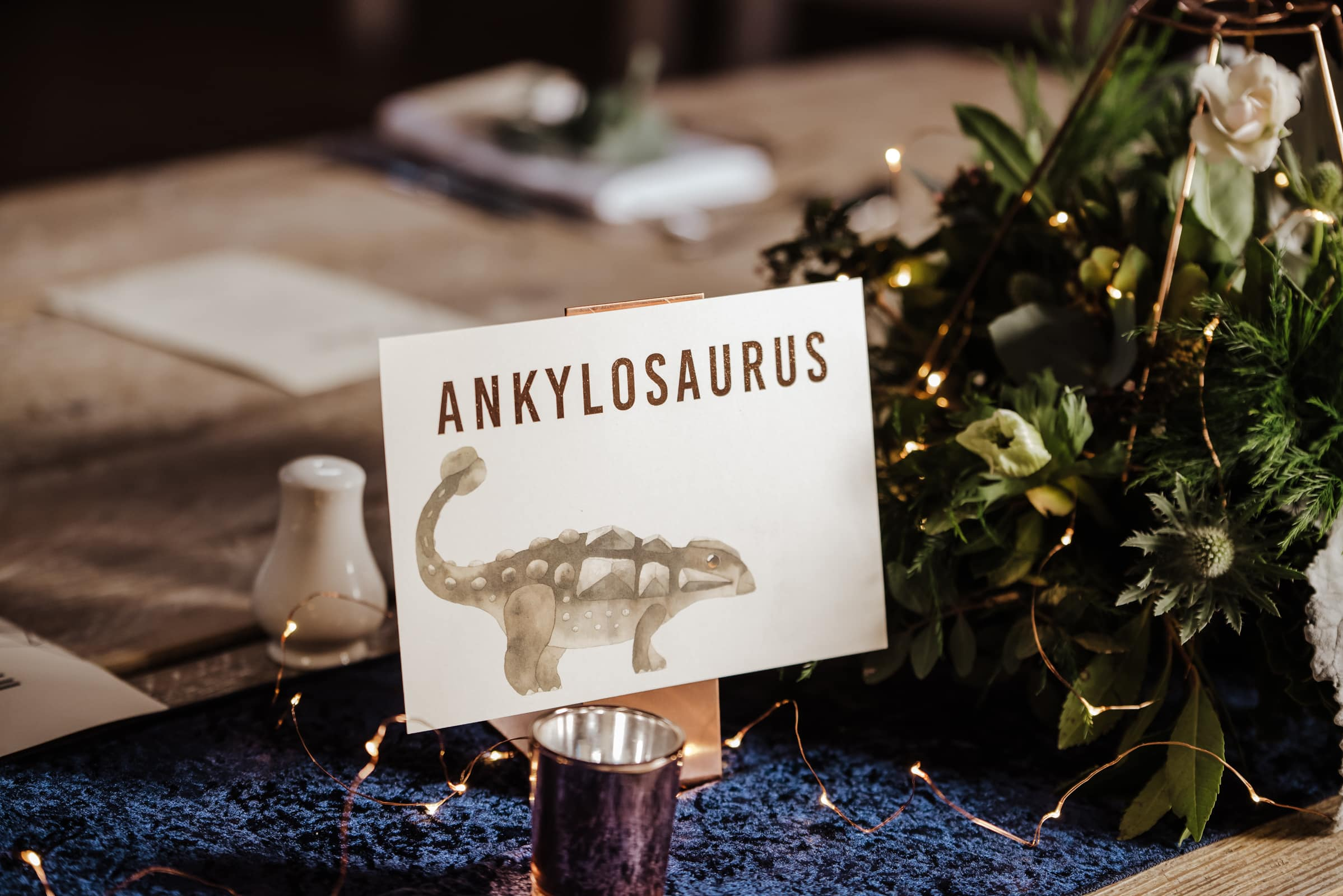 Wedding decor dinasour themed wedding menus Roshni photography The Milling Barn, Bluntswood Hall, Throcking wedding photographer