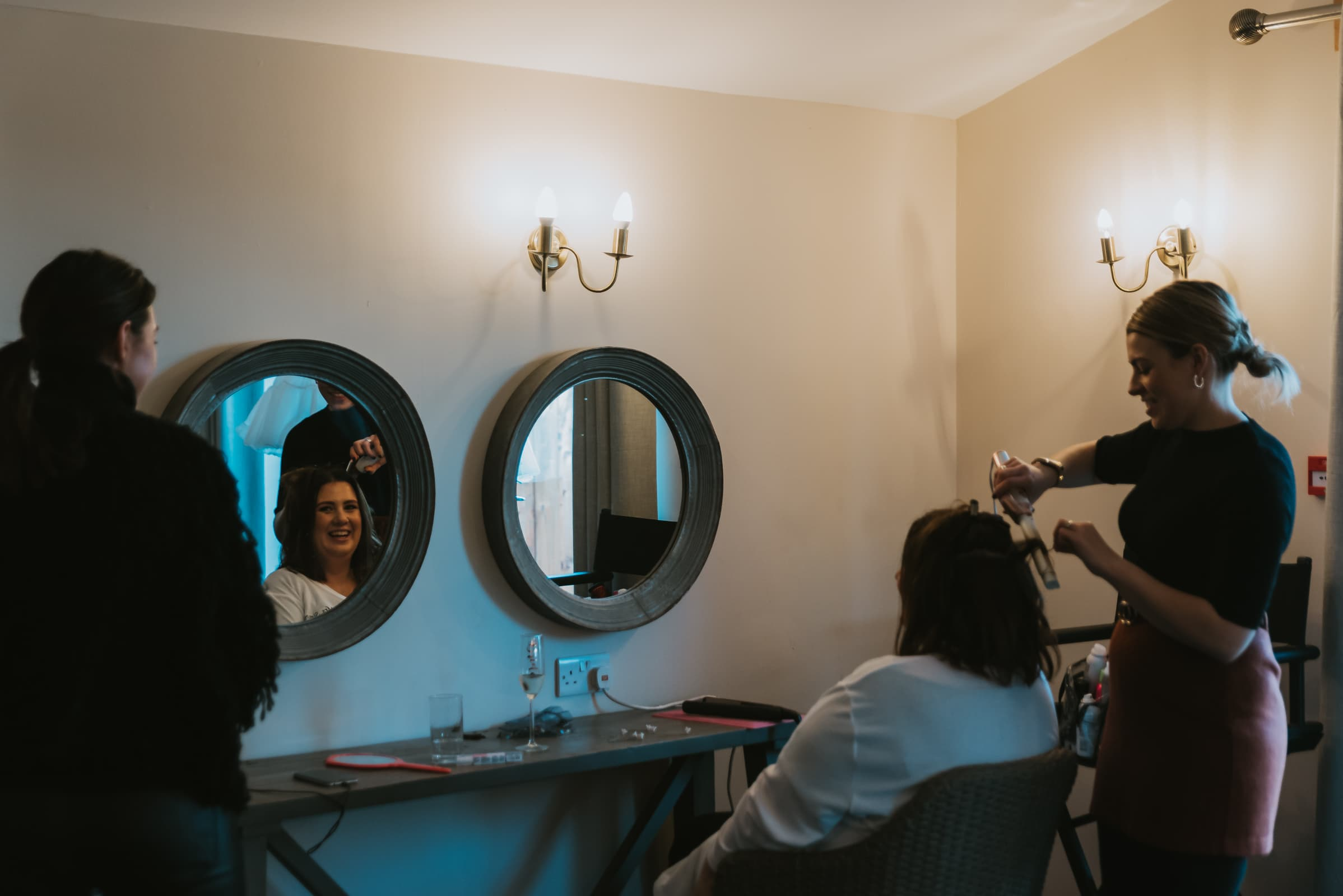 bride getting ready , hair curling Roshni photography The Milling Barn, Bluntswood Hall, Throcking wedding photographer