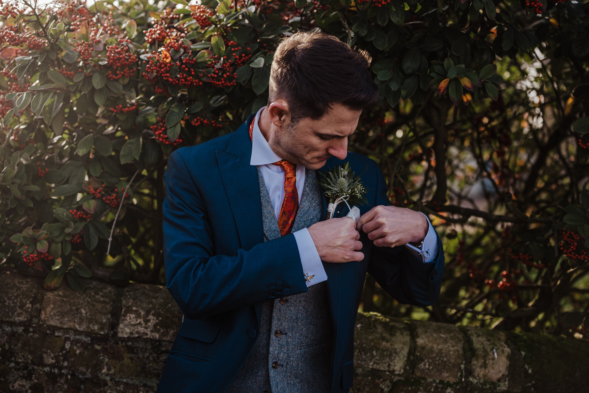 Groom in blue suits outside the barn before the wedding Roshni photography The Milling Barn, Bluntswood Hall, Throcking wedding photographer