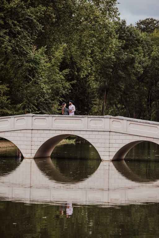 Couple on the bridge near a river at the Painshill Park Surrey engagement shootPainshill Park Surrey engagement shoot